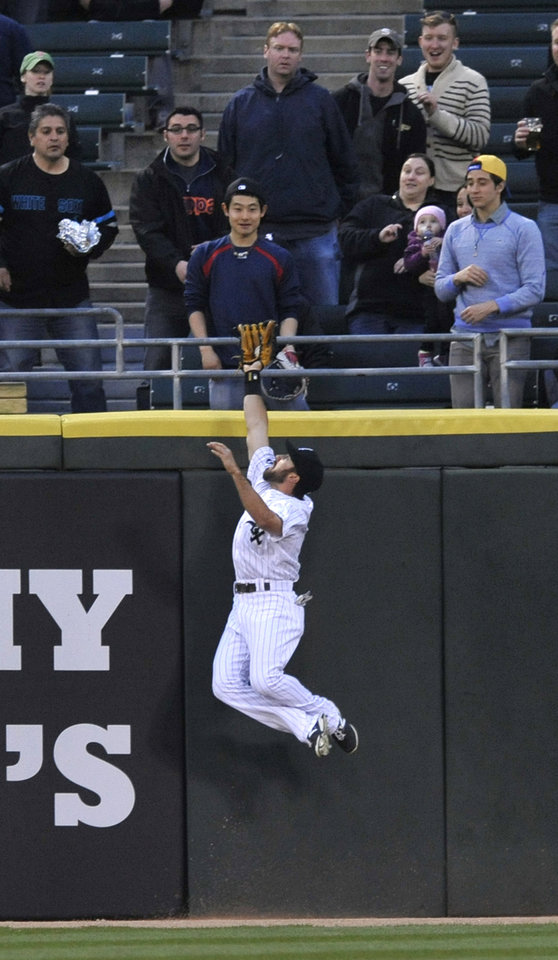 Photo - Chicago White Sox center fielder Adam Eaton catches a fly ball hit by Boston Red Sox's David Ortiz during the first inning of a baseball game in Chicago, Thursday, April 17, 2014. (AP Photo/Paul Beaty)