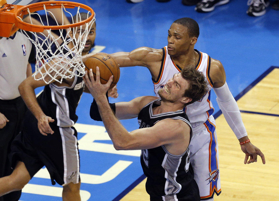 Photo - Oklahoma City's Russell Westbrook (0) defends against San Antonio's Tiago Splitter (22) during Game 4 of the Western Conference Finals in the NBA playoffs between the Oklahoma City Thunder and the San Antonio Spurs at Chesapeake Energy Arena in Oklahoma City, Tuesday, May 27, 2014. Photo by Bryan Terry, The Oklahoman