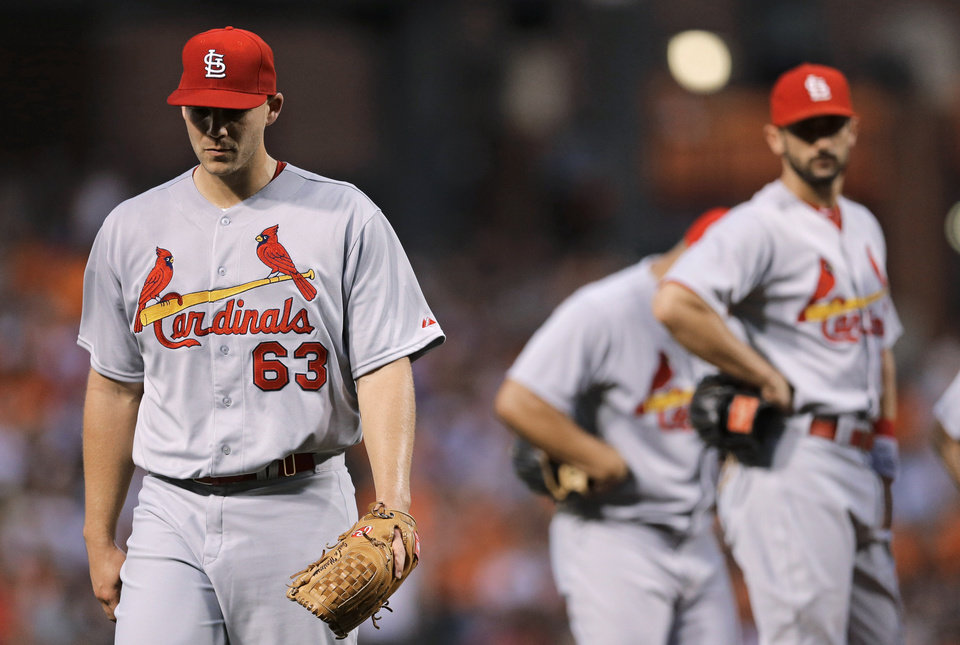 Photo - St. Louis Cardinals starting pitcher Justin Masterson, left, walks off the field after being relieved in the third inning of an interleague baseball game against the Baltimore Orioles, Friday, Aug. 8, 2014, in Baltimore. (AP Photo/Patrick Semansky)