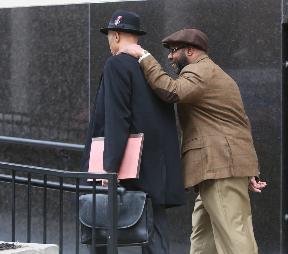 Photo - Bobby Ferguson, a friend of former Detroit Mayor Kwame Kilpatrick, walks into Federal Court with his lawyer Gerald Evelyn in Detroit on Monday, March 11, 2013. Ferguson has been convicted of a federal racketeering conspiracy charge. (AP Photo/Detroit Free Press, Diane Weiss)