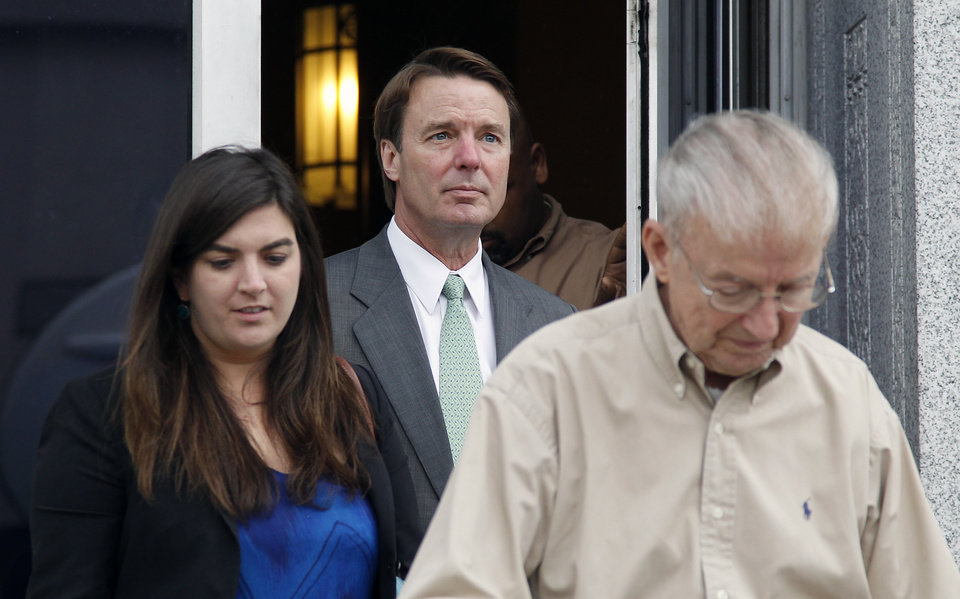 Photo -   Former presidential candidate and U.S. Sen. John Edwards follows his daughter, Cate, and father, Wallace Edwards, out of a federal courthouse during his trial in Greensboro, N.C., Monday, May 14, 2012. Edwards has pleaded not guilty to six criminal counts related to campaign finance violations. (AP Photo/Bob Leverone)