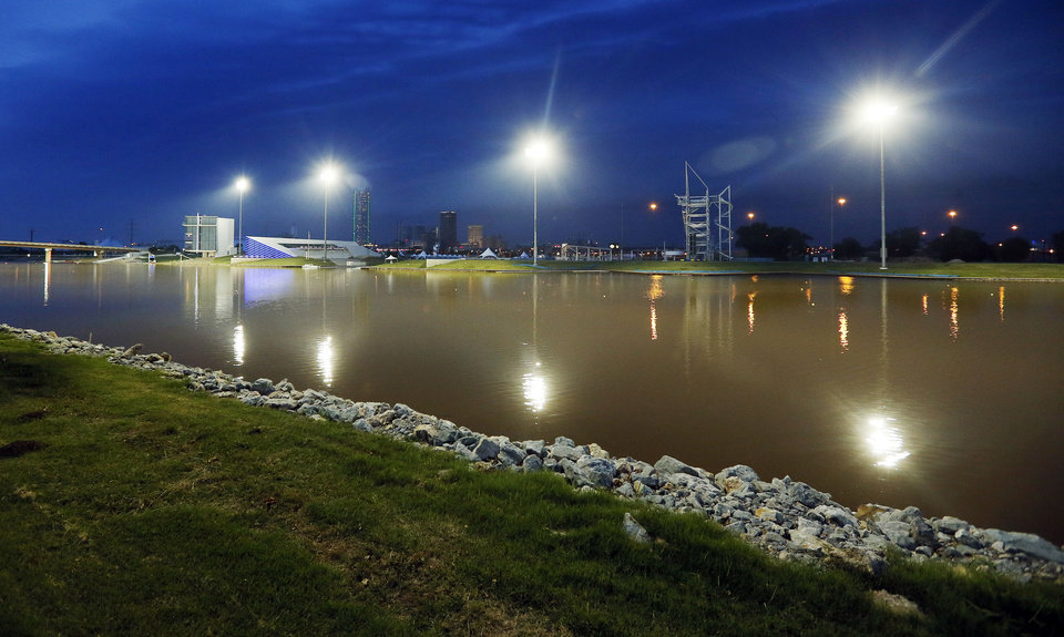 Photo - A view of the Boathouse District from the south with stadium lights illuminating the Oklahoma River in Oklahoma City, Thursday, June 27, 2013. Photo by Nate Billings, The Oklahoman