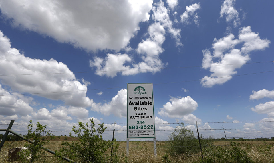 Photo -  Clouds drift over an empty lot where city and business leaders have proposed to locate the Sriracha chili sauce plant in Denton, Texas. AP Photo   LM Otero -  AP