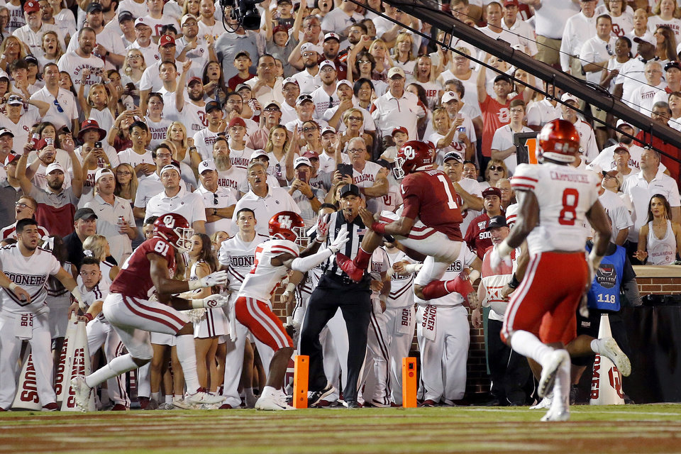 Photo - Oklahoma's Jalen Hurts (1) leaps for a touchdown during a college football game between the University of Oklahoma Sooners (OU) and the Houston Cougars at Gaylord Family-Oklahoma Memorial Stadium in Norman, Okla., Sunday, Sept. 1, 2019. Oklahoma won 49-31. [Bryan Terry/The Oklahoman]