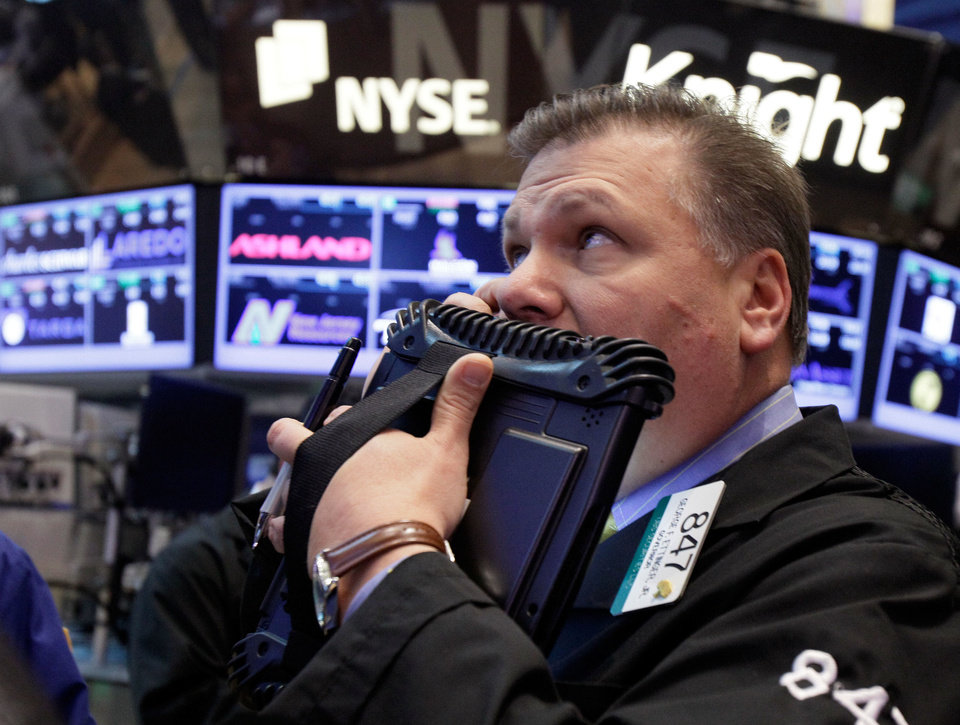 Photo - George Ettinger works on the floor of the New York Stock Exchange on Wednesday.  AP Photo