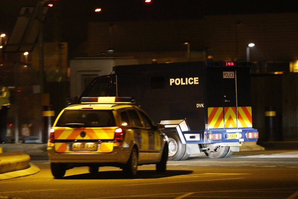 Photo - A police van carrying radical cleric Abu Qatada arrives, under escort, at RAF Northolt in London for his deportation to Jordan where he faces a retrial for his alleged involvement in terrorist plots, Sunday, July 7, 2013. Qatada's deportation was approved after Britain and Jordan signed a treaty agreeing that evidence obtained through torture would not be used against him at his retrial. (AP Photo/Sang Tan)