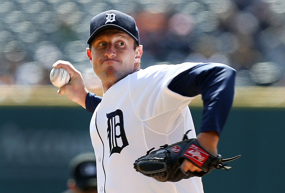 Photo - Detroit Tigers pitcher Max Scherzer throws against the Kansas City Royals in the first inning of a baseball game in Detroit Wednesday, April 2, 2014. (AP Photo/Paul Sancya)