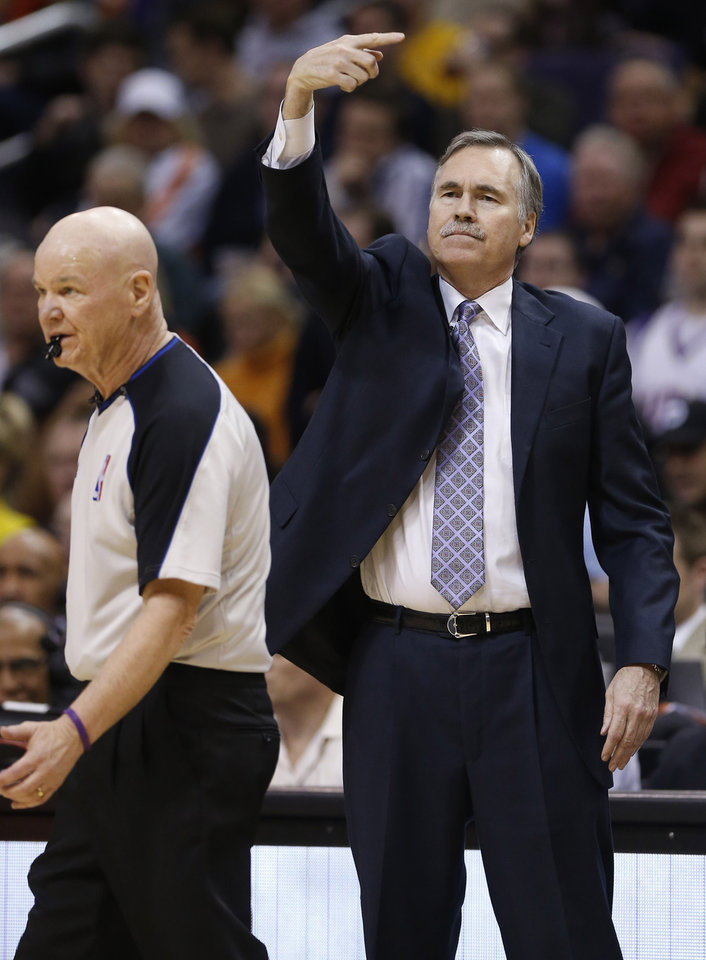 Los Angeles Lakers head coach Mike D'Antoni signals to his team against the Phoenix Suns during the first half of an NBA basketball game, Wednesday, Jan. 30, 2013, in Phoenix. (AP Photo/Matt York)