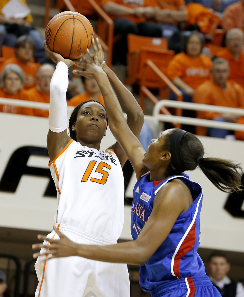 Oklahoma State's Toni Young (15) shoots the ball over Kansas' Chelsea Gardner (15) during a women's college basketball game between Oklahoma State University (OSU) and Kansas at Gallagher-Iba Arena in Stillwater, Okla., Tuesday, Jan. 8, 2013. Photo by Bryan Terry, The Oklahoman