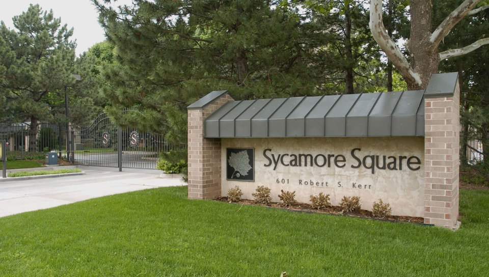 Photo -  Sycamore Square, 601 Robert S. Kerr Ave., was known for its neatly landscaped entrance under the ownership of Ed Fretwell when this photo was taken in 2005. Oklahoma Archives Photo   Roger Klock -  The Oklahoman