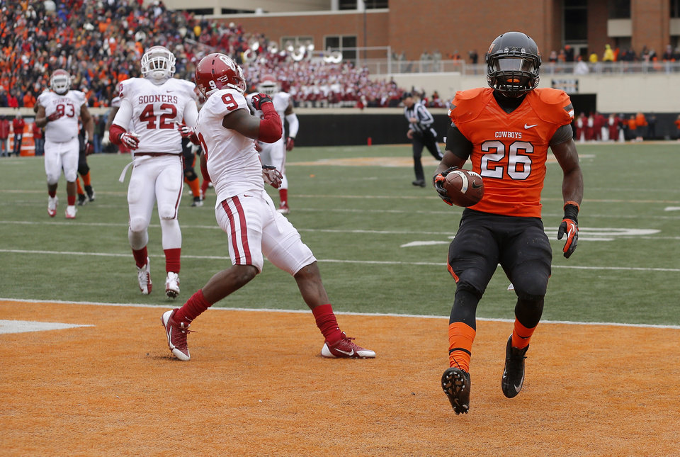 Photo - Oklahoma State's Desmond Roland (26) scores a touchdown beside Oklahoma's Gabe Lynn (9) and Dominique Alexander (42) during the Bedlam college football game between the Oklahoma State University Cowboys (OSU) and the University of Oklahoma Sooners (OU) at Boone Pickens Stadium in Stillwater, Okla., Saturday, Dec. 7, 2013. Oklahoma won 33-24. Photo by Bryan Terry, The Oklahoman