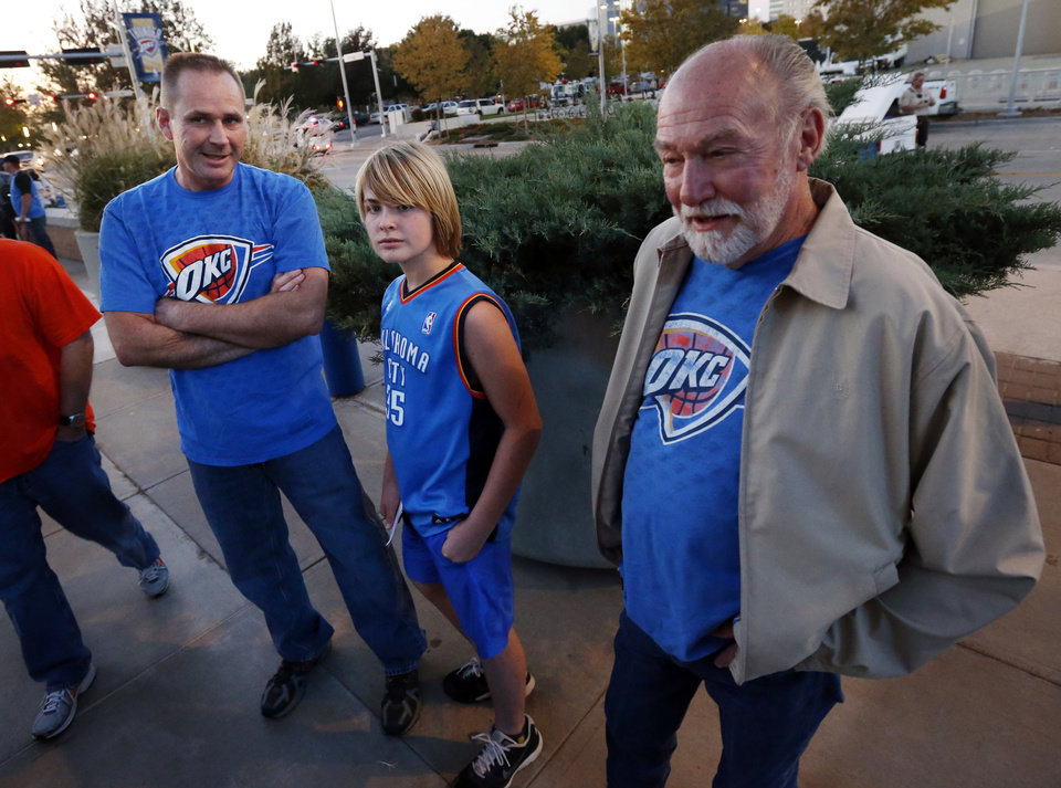 Photo - Ronnie and Jake Peacock and Ronnie's father-in-law Jim Boling, all from Edmond, wait outside the arena as the Oklahoma City Thunder play the Portland Trail Blazers in NBA basketball at the Chesapeake Energy Arena in Oklahoma City, on Friday, Nov. 2, 2012.  Photo by Steve Sisney, The Oklahoman