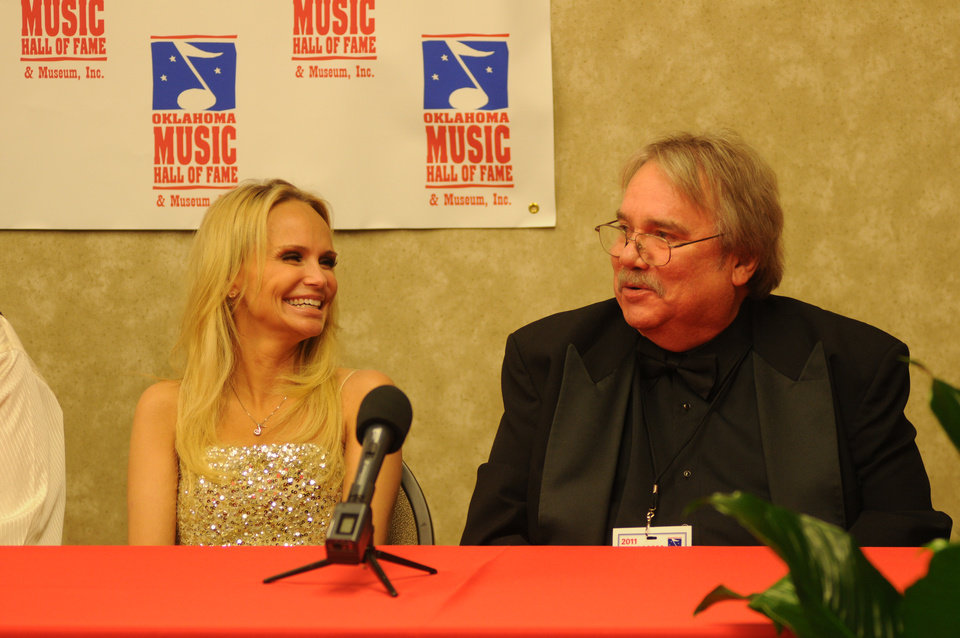 Photo - Singer and actress Kristin Chenoweth and The Oklahoman Entertainment Editor Gene Triplett speak about being inducted into the Oklahoma Music Hall of Fame on Thursday, Nov. 10, 2011, in Muskogee. Photo by Adam Kemp, For The Oklahoman.