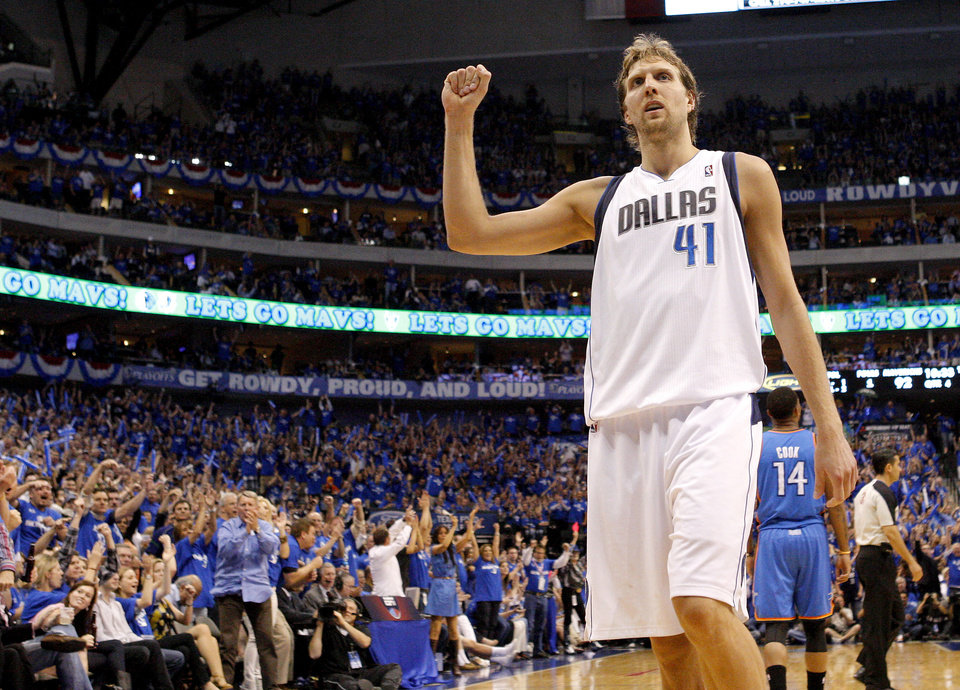 Photo - Dirk Nowitzki (41) of Dallas  reacts during game 1 of the Western Conference Finals in the NBA basketball playoffs between the Dallas Mavericks and the Oklahoma City Thunder at American Airlines Center in Dallas, Tuesday, May 17, 2011. Photo by Bryan Terry, The Oklahoman