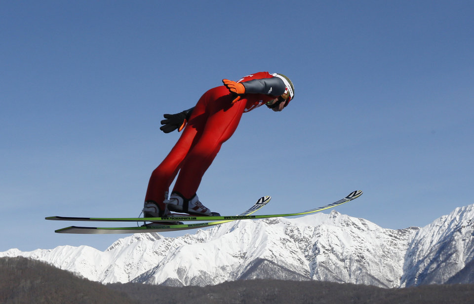 Photo - Poland's Kamil Stoch makes an attempt during the men's normal hill ski jumping training at the 2014 Winter Olympics, Friday, Feb. 7, 2014, in Krasnaya Polyana, Russia. (AP Photo/Matthias Schrader)