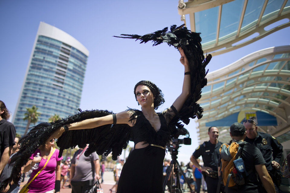 Photo - A woman dressed as the character Katniss Everdeen from the movie,