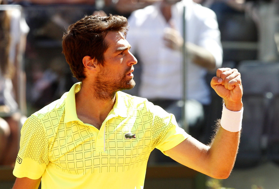 Photo - France's Jeremy Chardy celebrates after defeating Switzerland's Roger Federer at the Italian open tennis tournament in Rome, Wednesday, May 14, 2014. Roger Federer appeared to lose focus in his first match back after the birth of his second set of twins, losing to 47th-ranked Jeremy Chardy of France 1-6, 6-3, 7-6 (6) in the second round of the Italian Open on Wednesday. (AP Photo/Riccardo De Luca)