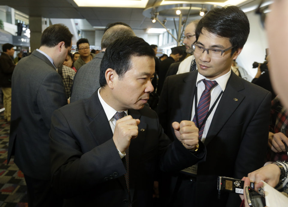Guangzhou Automobile Group President Xiangdong Huang talks with reporters at the North American International Auto Show in Detroit, Tuesday, Jan. 15, 2013. (AP Photo/Carlos Osorio)