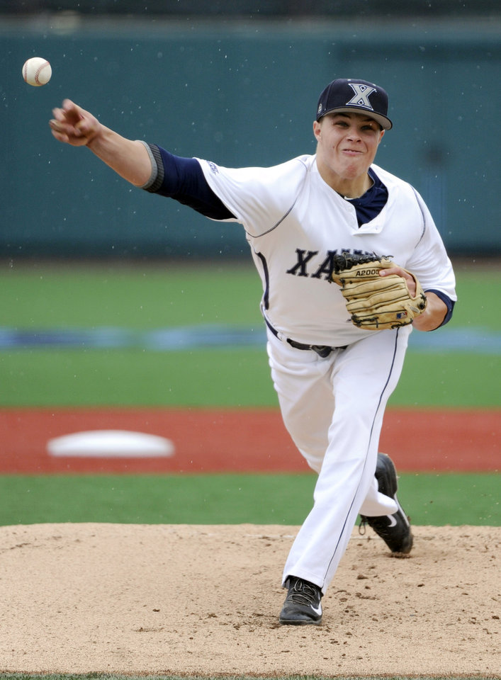Photo - Xavier pitcher Vinny Nittoli delivers the ball to St. John's during the first inning of an NCAA college baseball game in the Big East tournament Friday, May 23, 2014, in New York. Nittoli got the win as Xavier defeated St. John's 8-2. (AP Photo/Bill Kostroun)