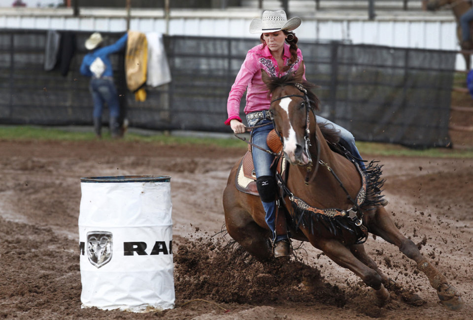 Photo - Eden Maples, Fort Gibson, OK, competing in a muddy Barrel Racing at the International Youth Finals Rodeo in Shawnee at the Heart of Oklahoma Exposition Center, Wednesday, July 9, 2014. Photo by David McDaniel, The Oklahoman