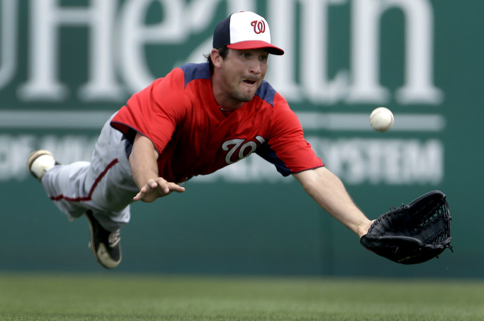 Washington Nationals right fielder Sean Nicol dives but cannot catch a ball hit for an RBI single by Miami Marlins\' Greg Dobbs during the sixth inning of an exhibition spring training baseball game Wednesday, March 20, 2013, in Jupiter, Fla. (AP Photo/Jeff Roberson)