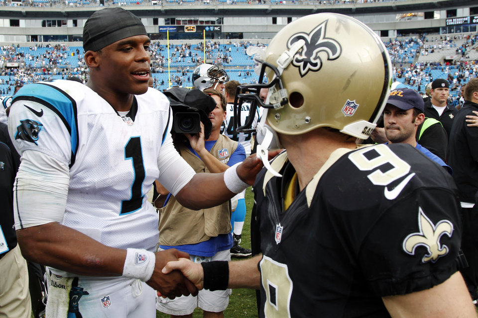 Photo -   Carolina Panthers quarterback Cam Newton (1) greets New Orleans Saints quarterback Drew Brees (9) after an NFL football game in Charlotte, N.C., Sunday, Sept. 16, 2012. The Panthers won 35-27. (AP Photo/Bob Leverone)