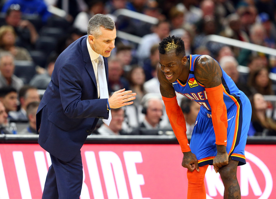 Photo - Jan 22, 2020; Orlando, Florida, USA; Oklahoma City Thunder head coach Billy Donovan talks with guard Dennis Schroder (17) against the Orlando Magic during the second half at Amway Center.  [Kim Klement/USA TODAY Sports]