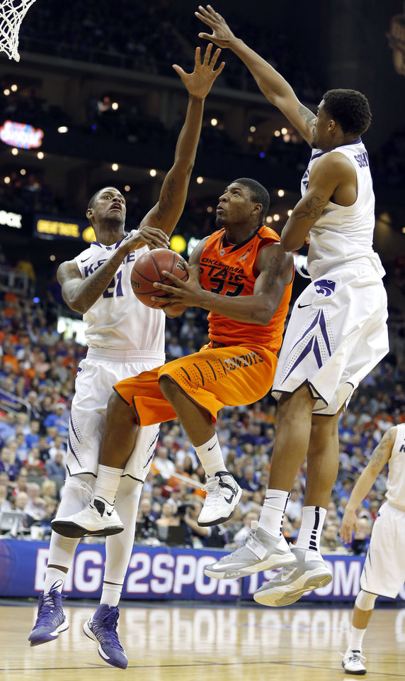 Oklahoma State\'s Marcus Smart (33) shoots in between Kansas State\'s Rodney McGruder (22) and Shane Southwell (1) during the Phillips 66 Big 12 Men\'s basketball championship tournament game between Oklahoma State University and Kansas State at the Sprint Center in Kansas City, Friday, March 15, 2013. Photo by Sarah Phipps, The Oklahoman