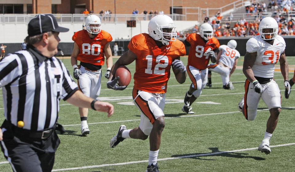 Photo - COLLEGE FOOTBALL: OSU's Johnny Thomas (12) returns an interception in front of Cooper Bassett (80), Anthony Rogers (94) and Jeremy Smith (31) during the Orange/White spring football game for the Oklahoma State University Cowboys at Boone Pickens Stadium in Stillwater, Okla., Saturday, April 16, 2011. Photo by Nate Billings, The Oklahoman ORG XMIT: KOD