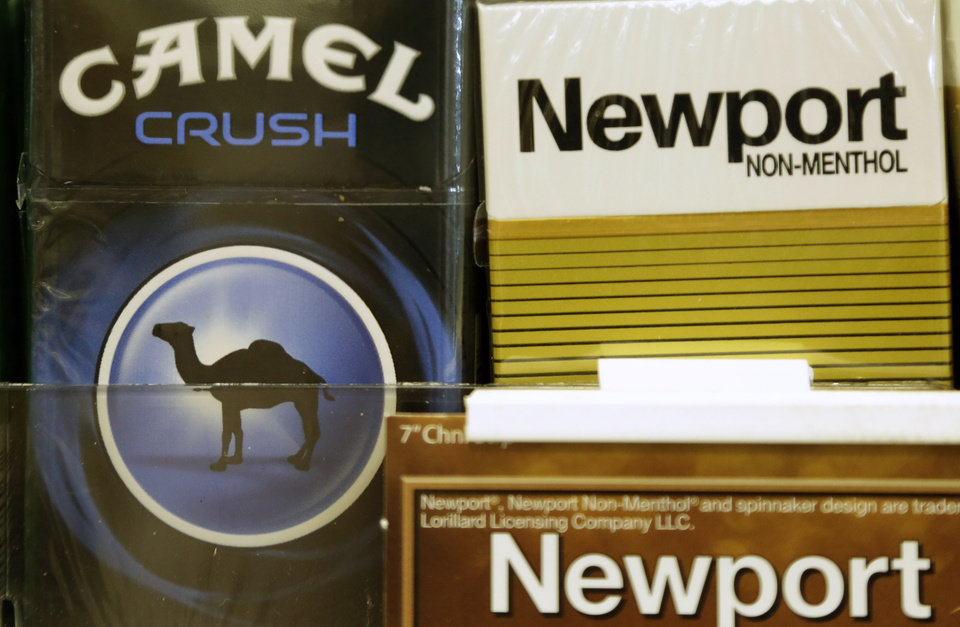 Photo - Camel and Newport cigarettes are displayed for sale, Tuesday, July 15, 2014, in Doral, Fla. Cigarette maker Reynolds American Inc. is planning to buy rival Lorillard Inc. for about $25 billion in a deal to combine two of the nation's oldest and biggest tobacco companies. (AP Photo/Lynne Sladky)