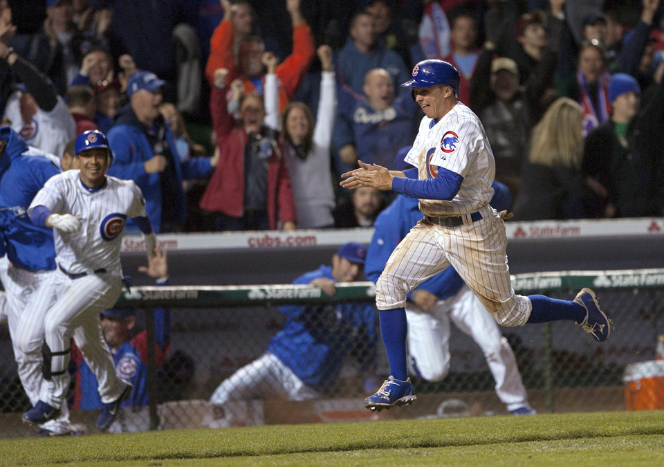 Photo -   Chicago Cubs' Tony Campana scores the winning run on Alfonso Soriano's hit in the 10th inning as the Cubs beat the St. Louis Cardinals 3-2 in a baseball game in Chicago on Tuesday, April 24, 2012. (AP Photo/Charles Cherney)