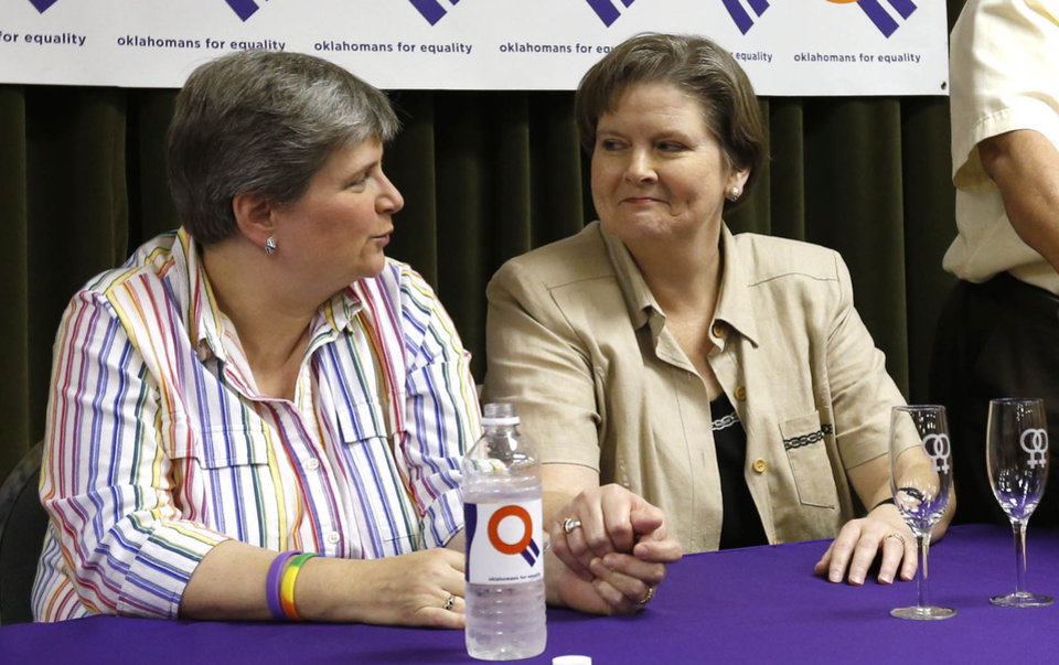 Photo -                    Plaintiffs Sharon Baldwin (left), and her partner Mary Bishop during a celebration of a decision by the 10th Circuit Appeals Court that Oklahoma's gay marriage ban is unconstitutional, taken in Tulsa on July 18.                                       AP Photo