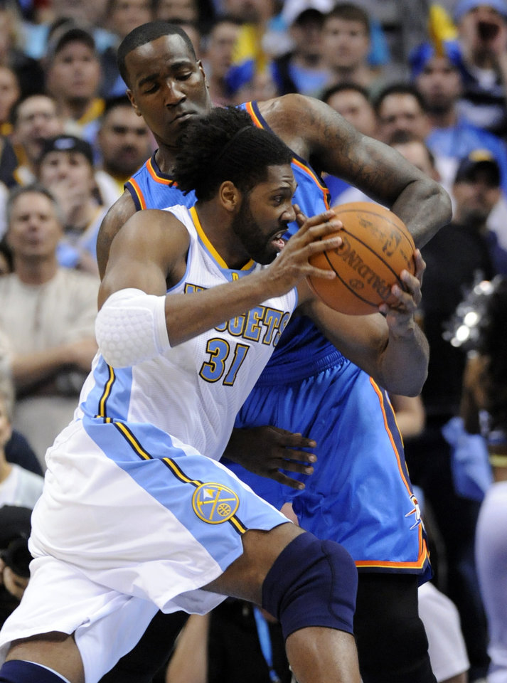 Photo - Denver Nuggets center Nene (31) from Brazil  drives around Oklahoma City Thunder forward Serge Ibaka (9) from the Republic of Congo during the first half in game 4 of a first-round NBA basketball playoff series Monday, April 25, 2011, in Denver. (AP Photo/Jack Dempsey)