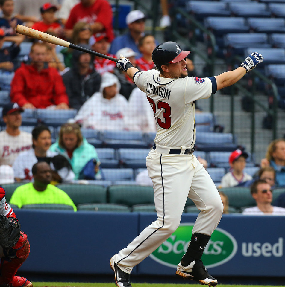 Photo - Atlanta Braves Chris Johnson hits a two-run homer  against the Philadelphia  Phillies during the second inning of a baseball game on Sunday, July 20, 2014, in Atlanta.  (AP Photo/Atlanta Journal-Constitution, Curtis Compton)