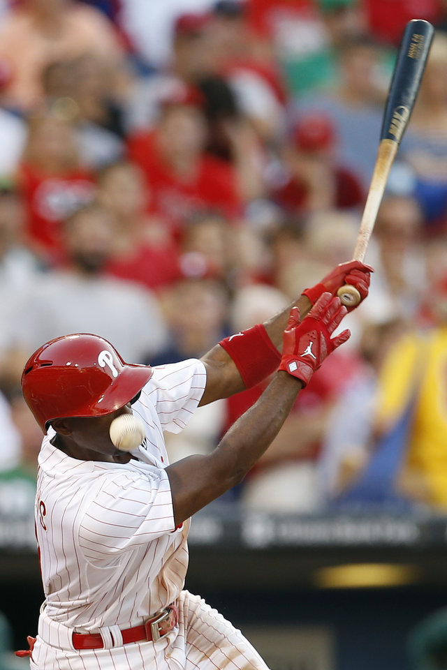 Photo - Philadelphia Phillies' Jimmy Rollins is hit in the face by a foul ball during the second inning of a baseball game against the Miami Marlins, Tuesday, June 24, 2014, in Philadelphia. (AP Photo/Matt Slocum)