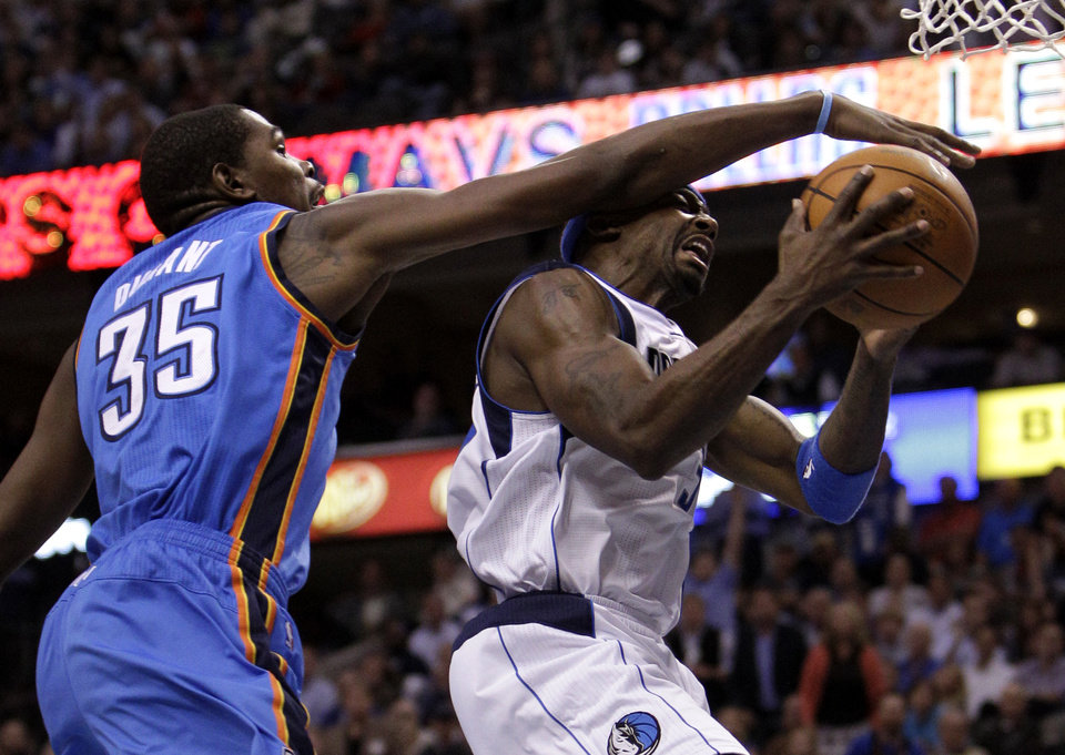 Dallas Mavericks\' Jason Terry, right, is defended against by Oklahoma City Thunder\'s Kevin Durant (35) on a shot-attempt in the second half of an NBA basketball game on Wednesday, Feb. 1, 2012, in Dallas. Terry had a team-high 25-points in the 95-86 loss to the Thunder. (AP Photo/Tony Gutierrez) ORG XMIT: DNA110