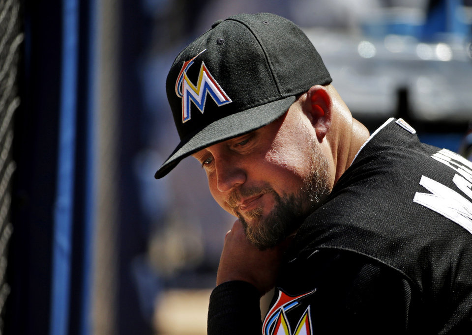 Photo - Miami Marlins' Casey McGehee sits in the dugout during the ninth inning of a baseball game against the Atlanta Braves, Wednesday, April 23, 2014, in Atlanta. The Braves won 3-1. (AP Photo/David Goldman)