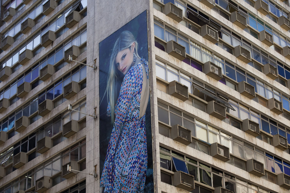 Photo -   A giant billboard advertising clothing is displayed on an office building in Rio de Janeiro, Brazil, Wednesday, May 2, 2012. Billboards on beachfront buildings, advertising along roadways and soccer fields, will now be torn down under the