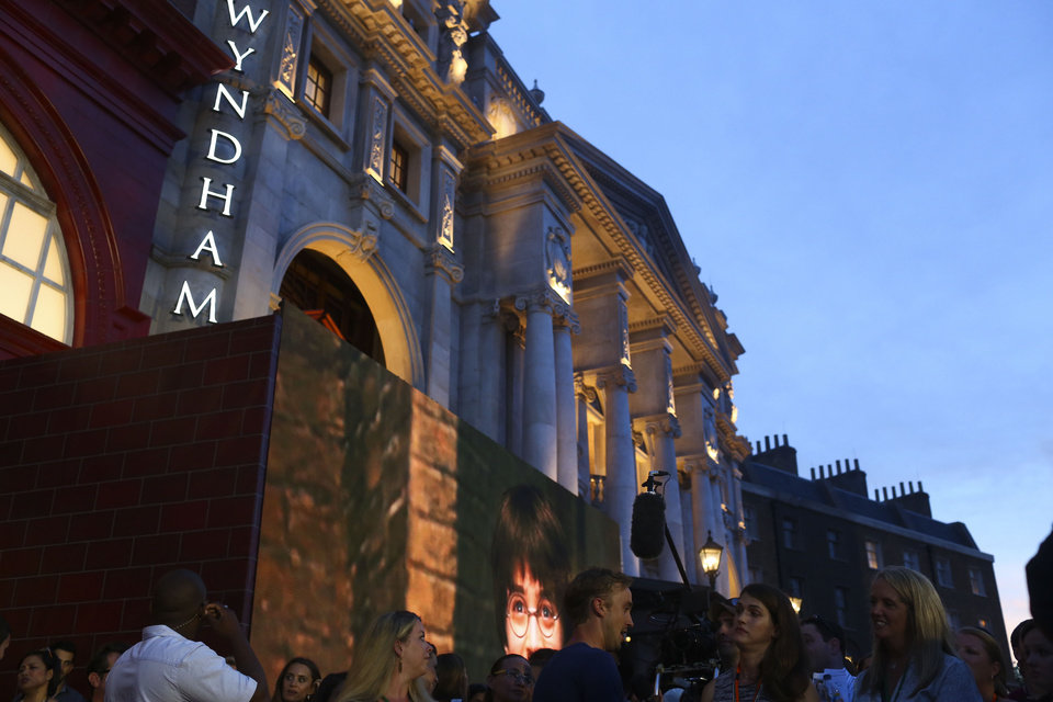Photo - The new London Embankment section is revealed during the Wizarding World of Harry Potter Diagon Alley preview event at Universal Studios Florida in Orlando on Wednesday, June 18, 2014. Diagon Alley will officially open to the public on July 8, 2014.  (AP Photo/The Tampa Bay Times, Eve Edelheit)