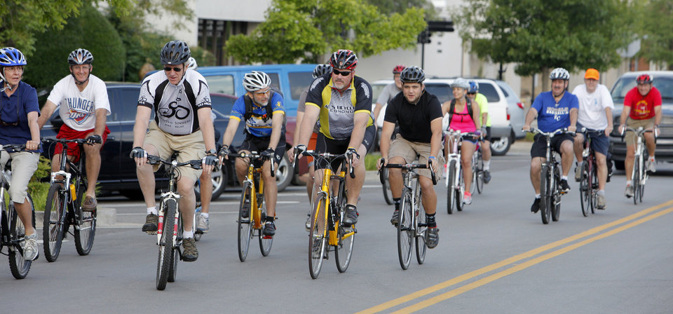 Photo -  Participants ride along First Street during a past Bike To Work Day in Edmond. Photo by Paul B. Southerland, The Oklahoman Archives   PAUL B. SOUTHERLAND -