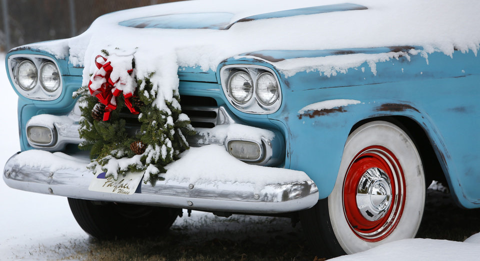 Photo - An old Chevrolet truck is covered in snow on Poplar Avenue in Yukon, Thursday December 6, 2013. Photo By Steve Gooch, The Oklahoman