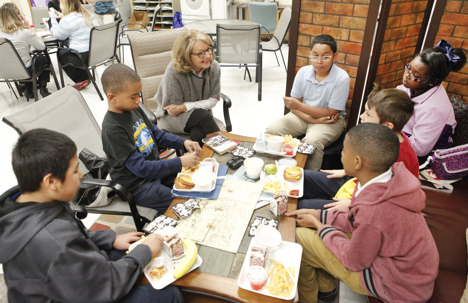 "Photo -      Helen Sullivan, from the Reading Club, discusses the book ""The Watsons Go to Birmingham"" with fifth-graders at Stanley Hupfeld Academy on Thursday. Photo by David McDaniel, The Oklahoman   David McDaniel -  The Oklahoman"