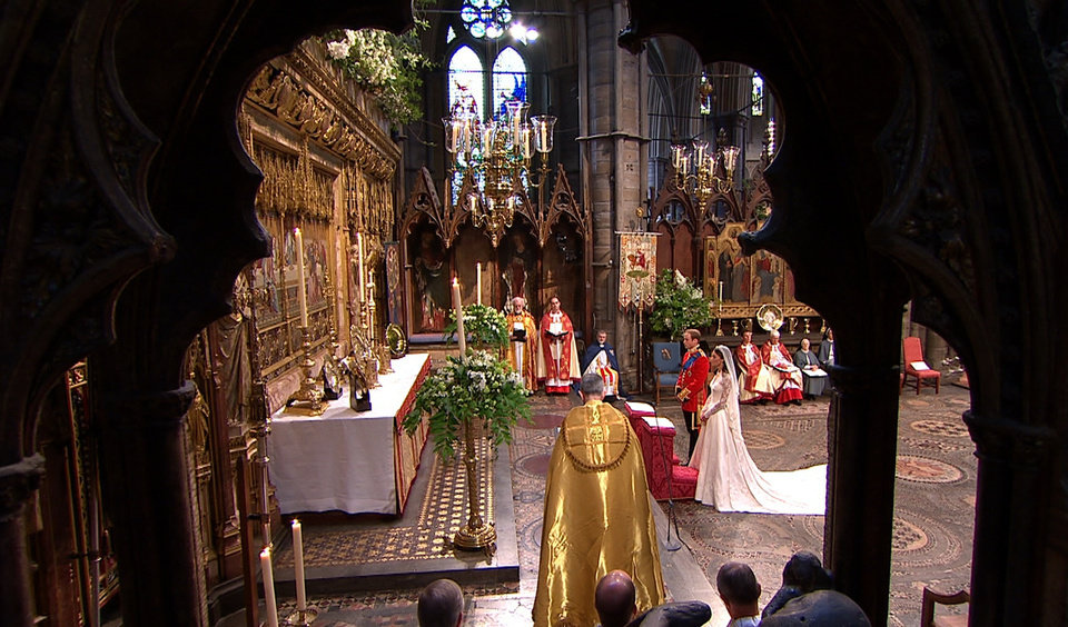 Photo - In this image taken from video, Britain's Prince William, left, and his wife, Kate, the Dutchess of Cambridge, stand at the altar at Westminster Abbey for the Royal Wedding in London on Friday, April, 29, 2011. (AP Photo/APTN) EDITORIAL USE ONLY NO ARCHIVE PHOTO TO BE USED SOLELY TO ILLUSTRATE NEWS REPORTING OR COMMENTARY ON THE FACTS OR EVENTS DEPICTED IN THIS IMAGE ORG XMIT: RWVM191