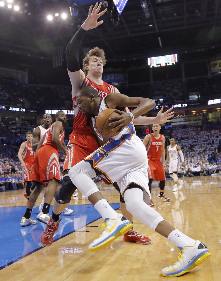 Photo - Oklahoma City's Kevin Durant (35) drives against Houston's Omer Asik (3) during Game 2 in the first round of the NBA playoffs between the Oklahoma City Thunder and the Houston Rockets at Chesapeake Energy Arena in Oklahoma City, Wednesday, April 24, 2013. Photo by Chris Landsberger, The Oklahoman