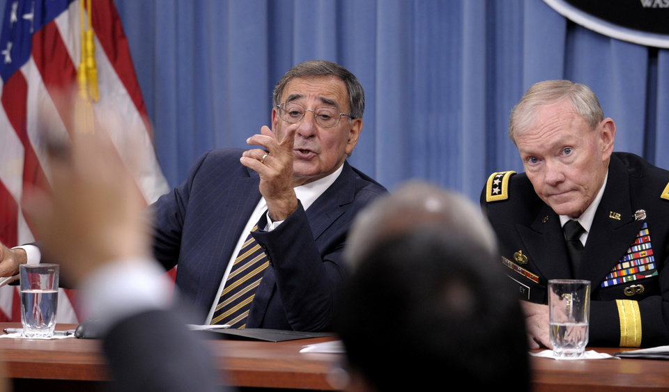 Photo -   FILE - In this this May 10, 2012 file photo, Defense Secretary Leon Panetta and Joint Chiefs Chairman Gen. Martin E. Dempsey take part in a news conference at the Pentagon in Washington, on the defense budget. Is the U.S. spending enough money on defense, and is it spending it in the right ways? In the aftermath of the 9/11 terrorist attacks the money spigot was turned wide open, pouring hundreds of billions of dollars into the wars in Iraq and Afghanistan and expanding the armed forces. Now that's changing, and an important issue in the election is whether budget cuts have gone too far. (AP Photo/Susan Walsh)
