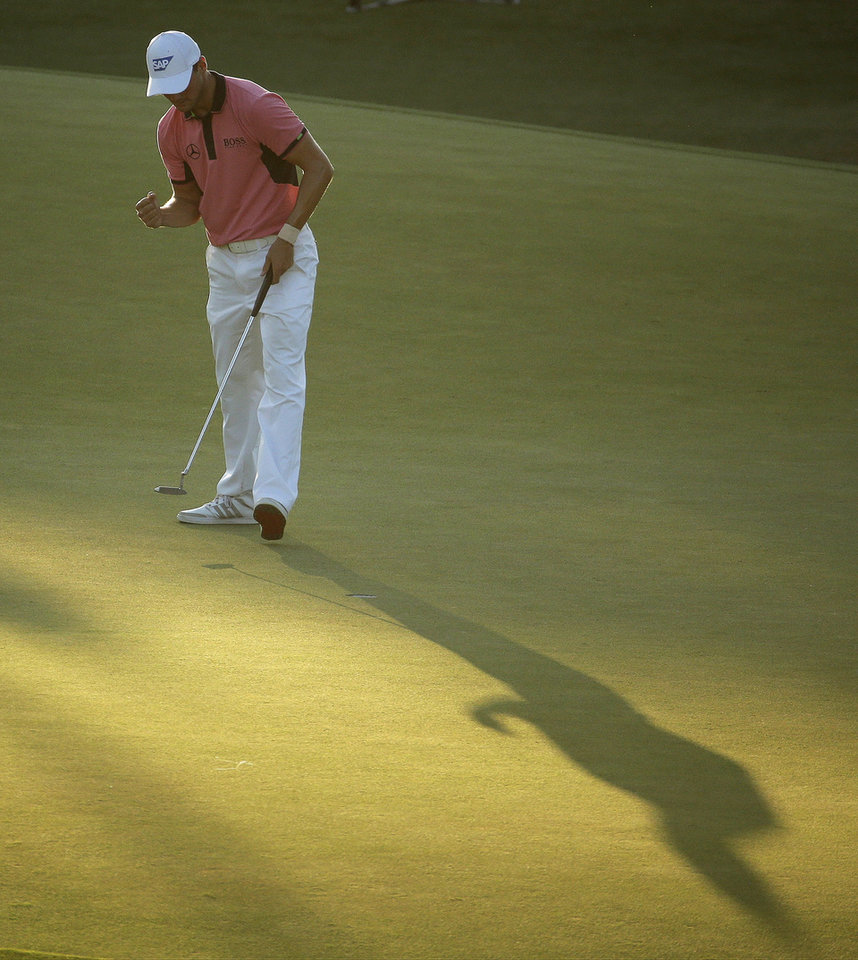 Photo - Martin Kaymer, of Germany, celebrates after making his putt on the 18th hole during the third round of the U.S. Open golf tournament in Pinehurst, N.C., Saturday, June 14, 2014. (AP Photo/Charlie Riedel)