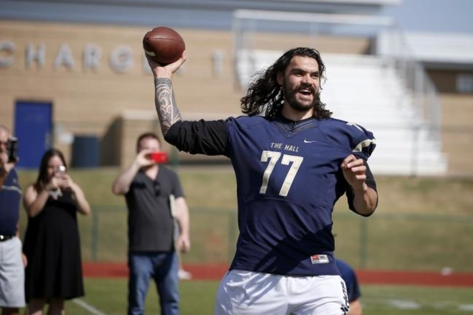 Photo -  Steven Adams became a fan favorite in Oklahoma City for his play and his personality. Adams took a few snaps at quarterback during a Heritage Hall football practice in 2016. [Bryan Terry/The Oklahoman]