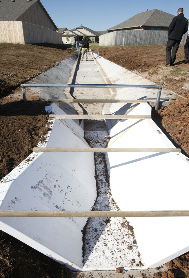 A trough will be used to measure and compare water runoff against a comparable nearby street using a natural system for runoff water filtration in Norman�s Trail Woods addition.PHOTO BY PAUL HELLSTERN, THE OKLAHOMAN