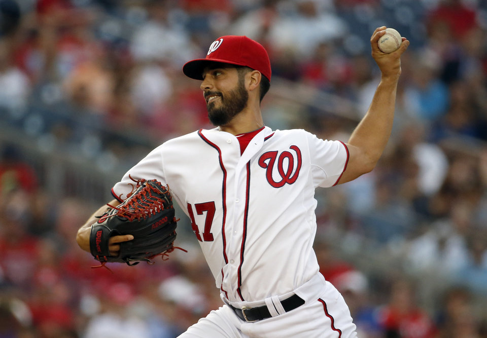 Photo - Washington Nationals starting pitcher Gio Gonzalez throws during the third inning of a baseball game against the Philadelphia Phillies at Nationals Park Thursday, July 31, 2014, in Washington. (AP Photo/Alex Brandon)