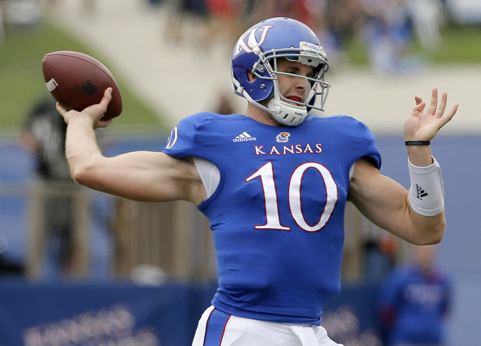 Photo -   Kansas quarterback Dayne Crist (10) passes during the first half of an NCAA college football game against the TCU, Saturday, Sept. 15, 2012, in Lawrence, Kan. (AP Photo/Charlie Riedel)